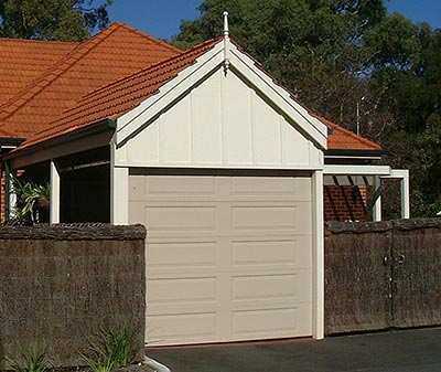 A Brisbane carport with a roller door or other door system installed.